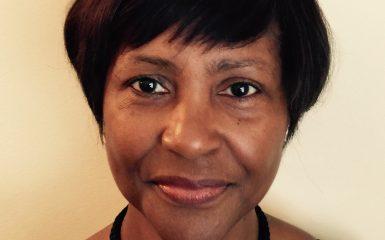 Dr Joan St John
