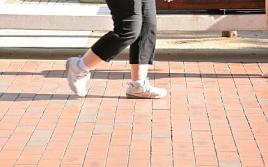 Legs of woman with sport shoes walking