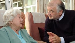 Professor Alan Sinclair talking to a care home resident