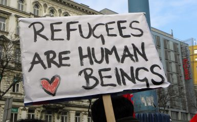 A banner which says Refugges are human beings